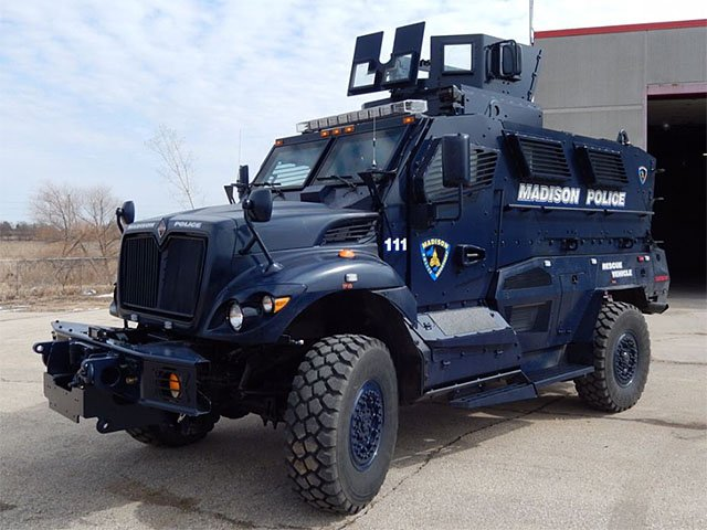 Cover-Militarized-Police-Armored-Vehicle-08132015.jpg