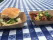 A Pig in a Fur Coat's pig's head torta (left) joined by Sal's pulled pork with piri piri sauce, potatoes, peas and corn kernels.