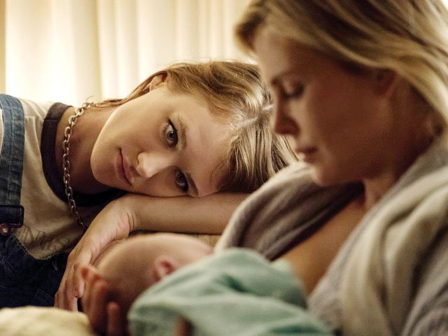 In 'Tully,' Charlize Theron offers a fearless look at modern motherhood