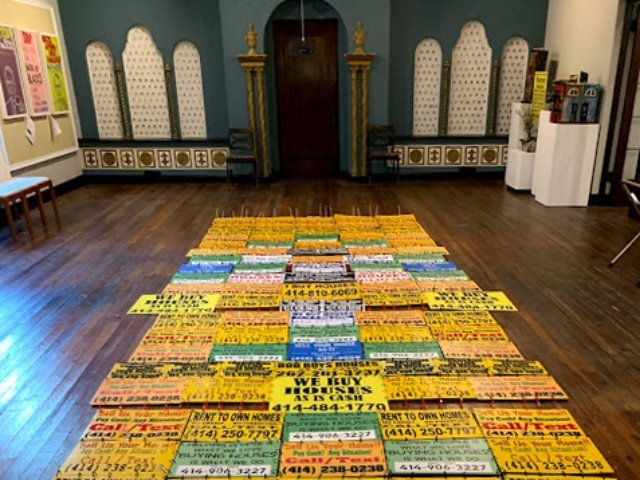 """""""Displacement Welcome Runner"""" at Signs O' The Times exhibit at 5 Points Art Gallery and Studios in Milwaukee"""